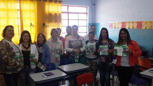 Orbianos junto das pessoas ligadas ao setor de Educação em Santa Rita de Minas